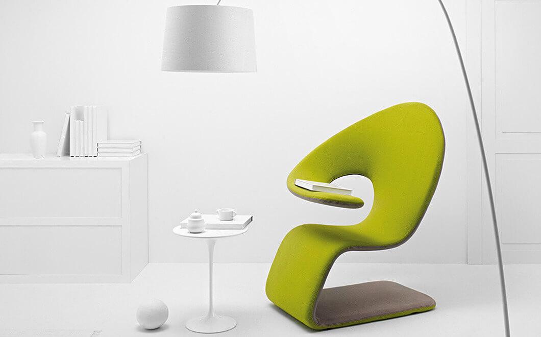 Дизайнерское кресло зеленого цвета